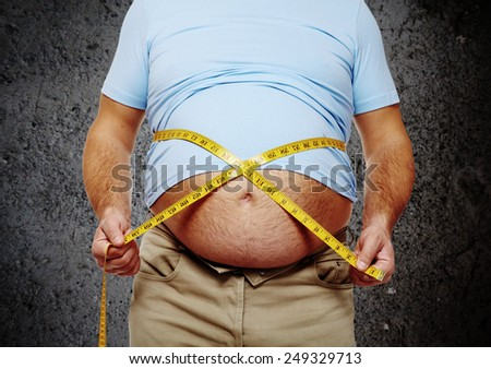 Fat belly. Man with overweight abdomen. Weight loss concept. - stock photo