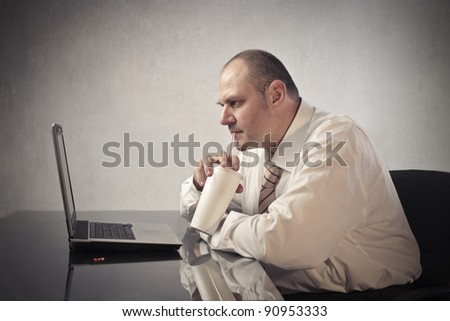 Fat businessman drinking a sparkling beverage - stock photo
