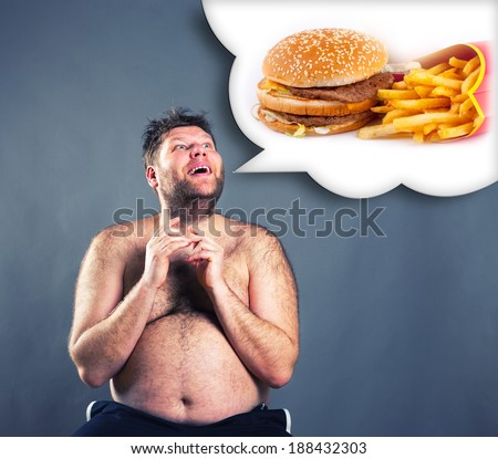 Fat funny man dreaming about  hamburger - stock photo