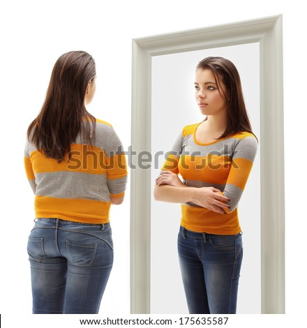 Fat girl  looking at herself in the mirror. White background - stock photo