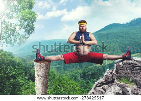 Fat man does the splits - stock photo