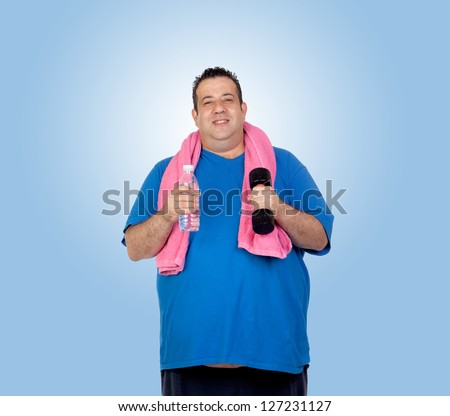 Fat man in the gym with a water bottle isolated on a blue background - stock photo
