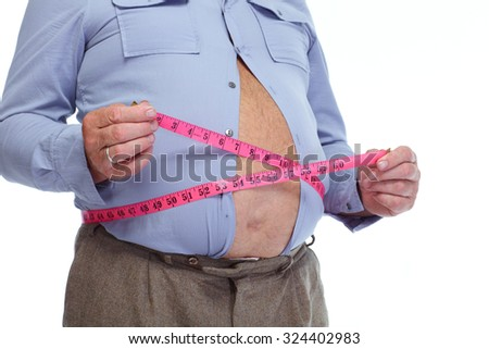 Fat man measuring his big stomach. Weight loss concept. - stock photo