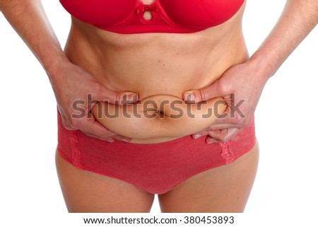 Fat stomach. - stock photo