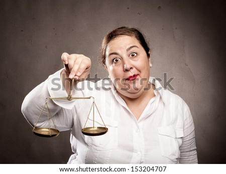 fat woman holding a scale - stock photo