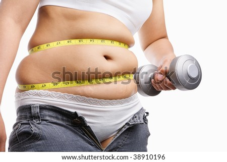 fat woman holding weight to exercise with measuring tape around her belly, a concept to fight obesity - stock photo