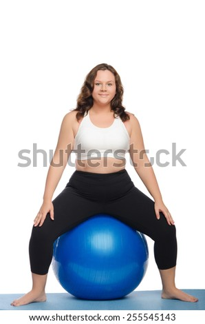 fat woman sitting on blue ball fitness isolated on white - stock photo