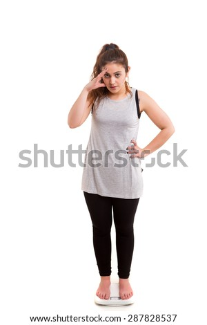 Fat woman very worried about her weight - stock photo