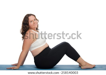 fat woman with overweight involved in fitness on blue mat - stock photo