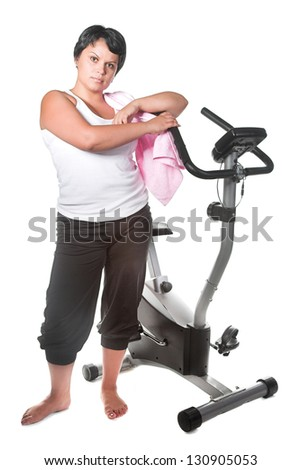 fat woman workout on the bicycle - stock photo