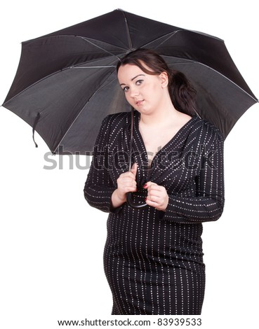 fat young woman in dark dress with umbrella - stock photo