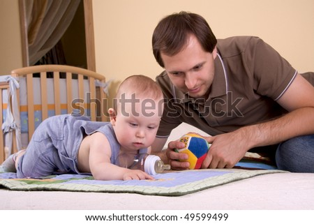 Father and baby boy playing - stock photo