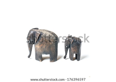 Father and baby wooden elephant on white background - stock photo
