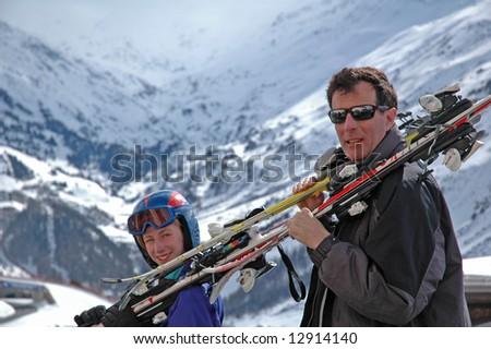 father and child going skiing - stock photo