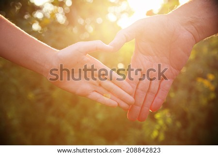Father and child hands. Instagram effect - stock photo