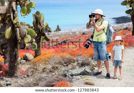 Father and daughter at scenic terrain on Galapagos South Plaza island - stock photo