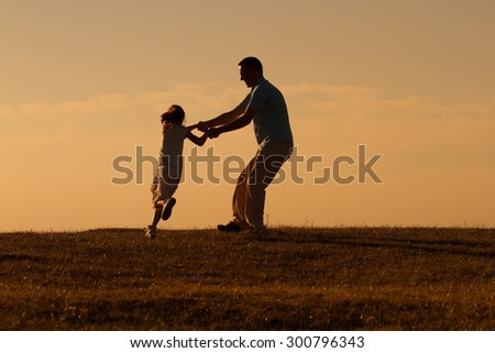 Father and daughter enjoy spending time together outdoor.Precious family moments - stock photo