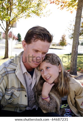 Father and daughter having fun at the park - stock photo