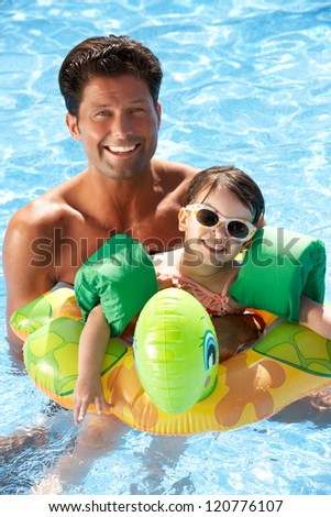 Father And Daughter Having Fun In Swimming Pool - stock photo