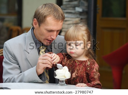 father and daughter in cafe - stock photo