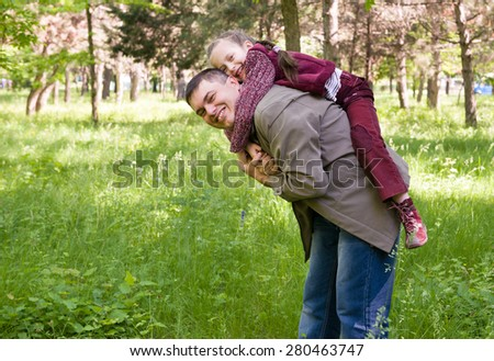 Father and daughter in the park at spring - stock photo