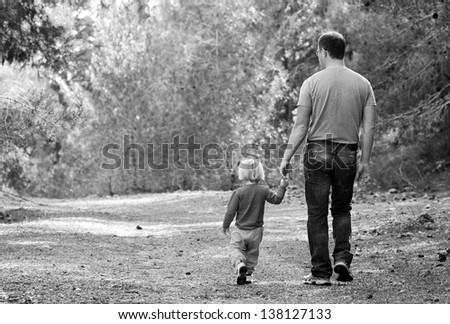 father and daughter in the spring forest - stock photo