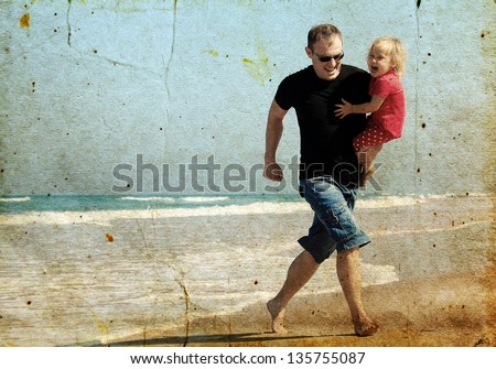 father and daughter on the beach. Photo in old image style. - stock photo