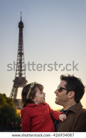 Father and daughter on vacation in Paris. Background Eiffel Tower - stock photo