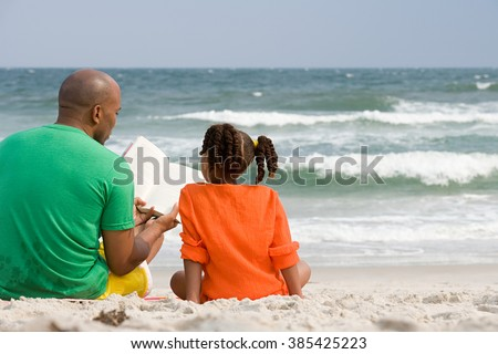 Father and daughter reading - stock photo