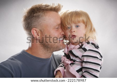 Father and daughter's curious expression - stock photo