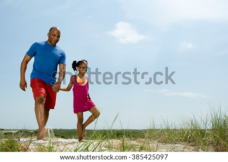 Father and daughter walking - stock photo
