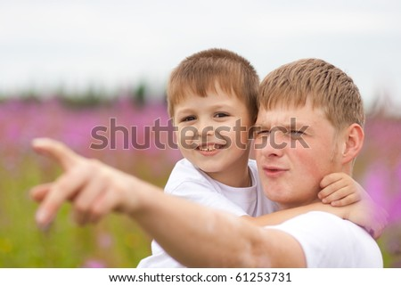 Father and happy son having fun outdoor - stock photo