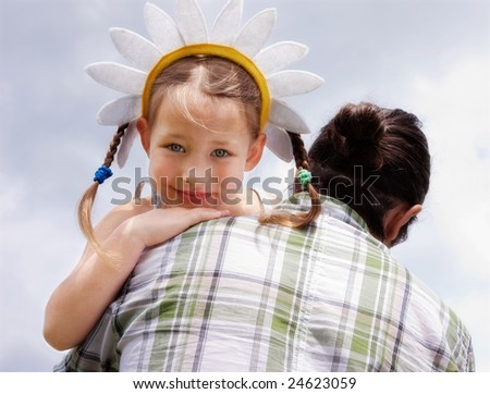 Father and his daughter are having a walk outdoors - stock photo