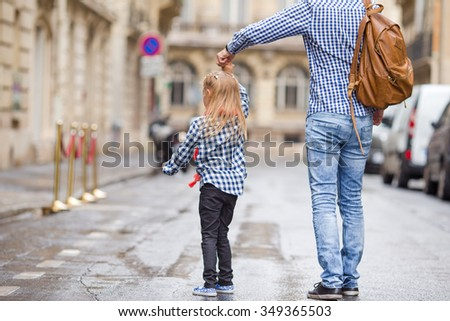 Father and his little daughter outdoors in European city - stock photo