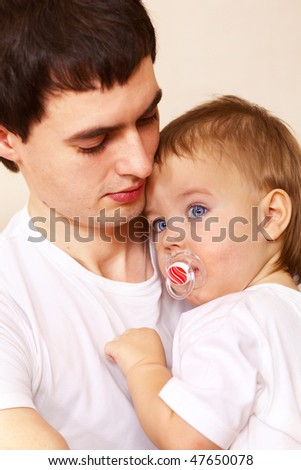 father and his little son; closeup face - stock photo