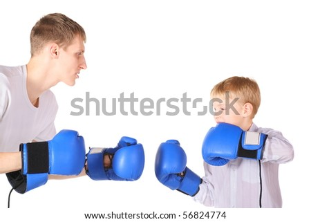 father and his son is boxing with boxing gloves. isolated. - stock photo