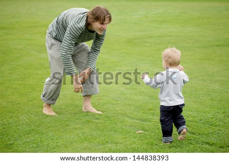 Father and his son laying in the park - stock photo