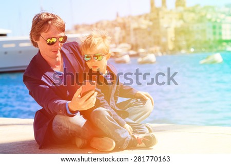 father and little son making selfie while travel in Europe, Malta - stock photo
