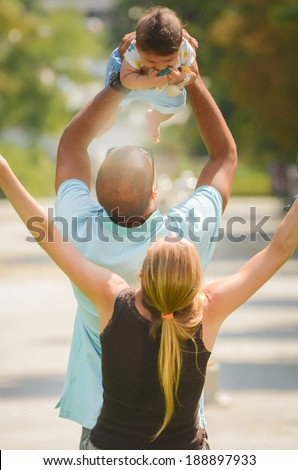 Father and mother are celebrating with their son - stock photo