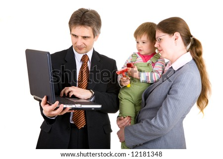 father and mother dressed for business with child look into the notebook - stock photo