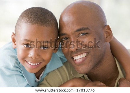 Father and son at home - stock photo
