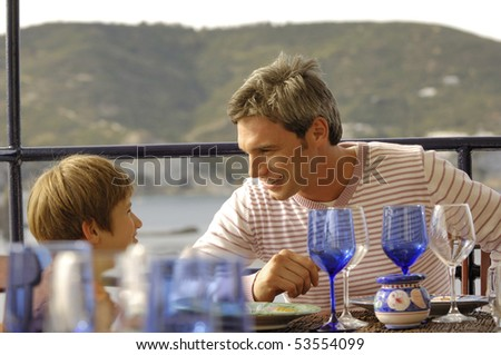 father and son at restaurant - stock photo