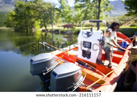 Father and son boating on lake - stock photo