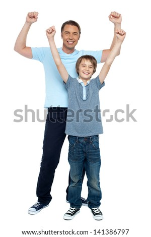 Father and son enjoying their victory - stock photo