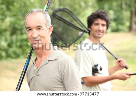 Father and son eon fishing trip - stock photo