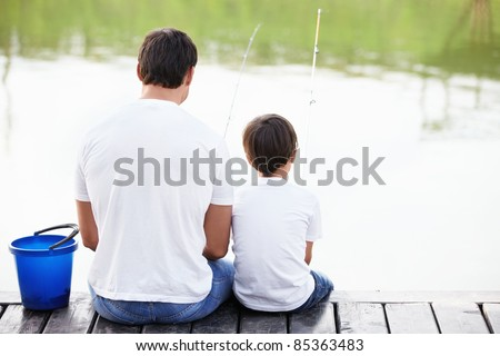 Father and son go fishing - stock photo