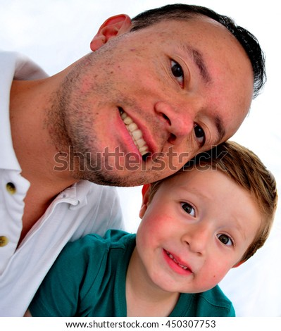 Father and son happy smiling at the camera. - stock photo