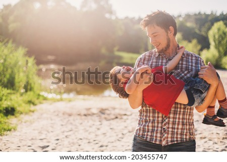 Father and son having fun outdoors - stock photo