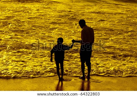 Father and son having intimacy at a local beach - stock photo