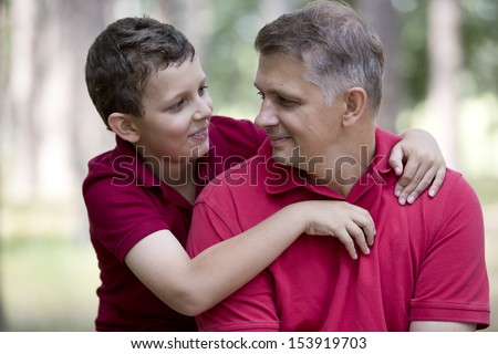 Father and son hug - stock photo